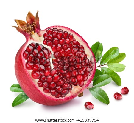 Pomegranate fruit with green leaves on the white background. - stock photo