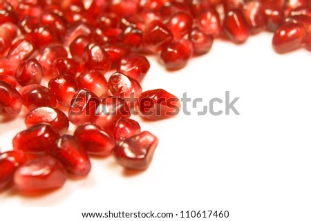 pomegranate grains close-up in the form of heart