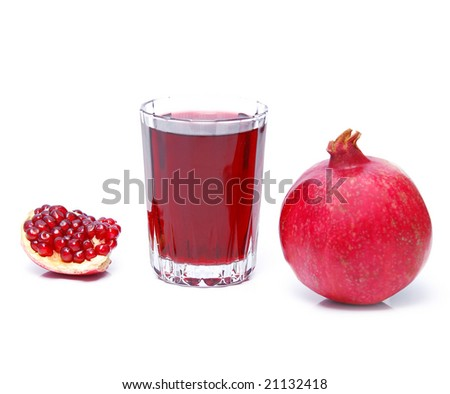 pomegranate juice and fruit over white