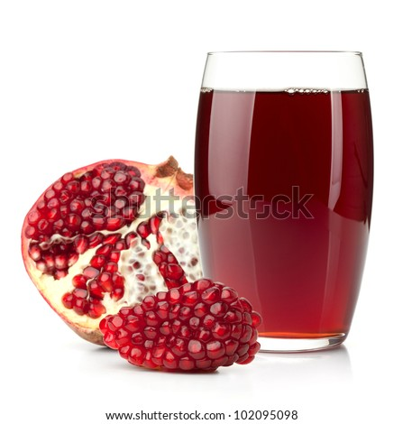 Pomegranate juice in a glass and ripe pomegranate. Isolated on white background - stock photo