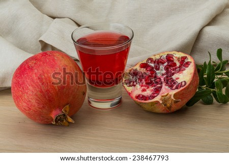 pomegranate Juice with fruit on the wood background