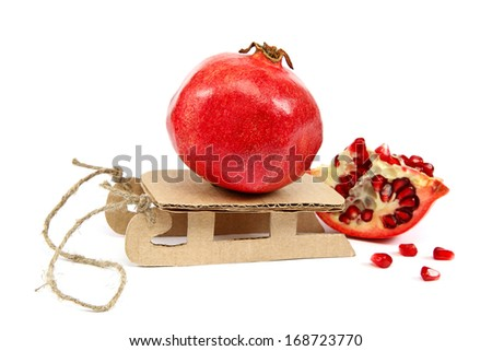 Pomegranate on a sled isolated on white background.