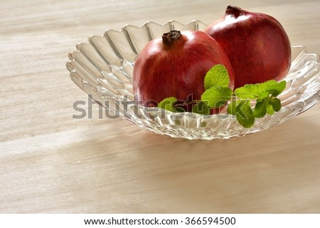 pomegranate on a wood table