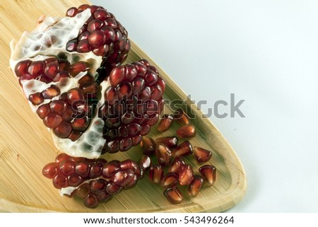 pomegranate on a wooden plate