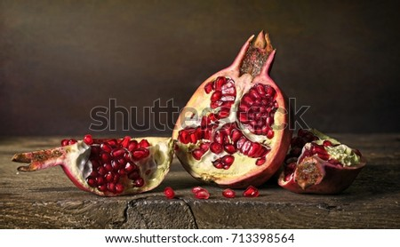 Pomegranate on wood. Imitation of antique still life painting.