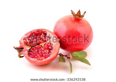 Pomegranate. Pomegranate  on white. Pomegranate fruit. Pomegranate seeds. - stock photo