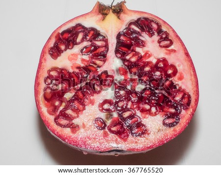 Pomegranate (Punica granatum) is a fruit-bearing deciduous shrub or small tree growing between 5 and 8 m (16 and 26 ft) tall. - stock photo