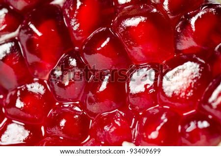 Pomegranate seeds background. Studio shot - stock photo