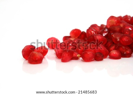 pomegranate  seeds closeup healthy eating isolated with reflection