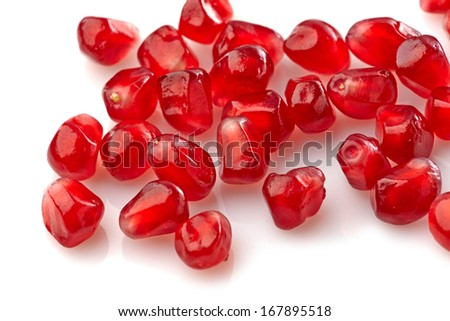 pomegranate seeds on a white background