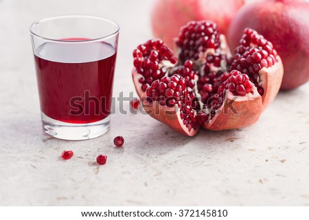 Pomegranates and pomegranate juice - stock photo