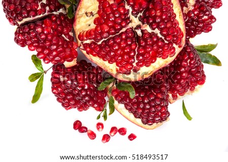 Pomegranates fruit with cut open on white background