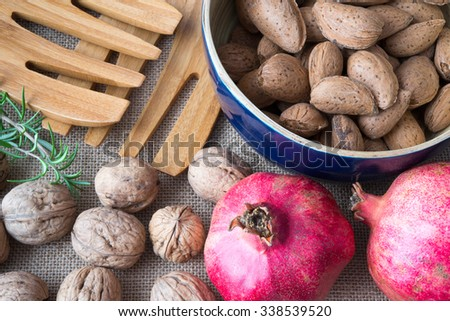 pomegranates, walnuts, almonds and rosemary