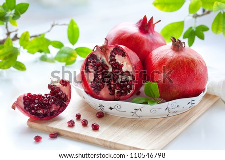 Pomegranates, whole and cut open - stock photo