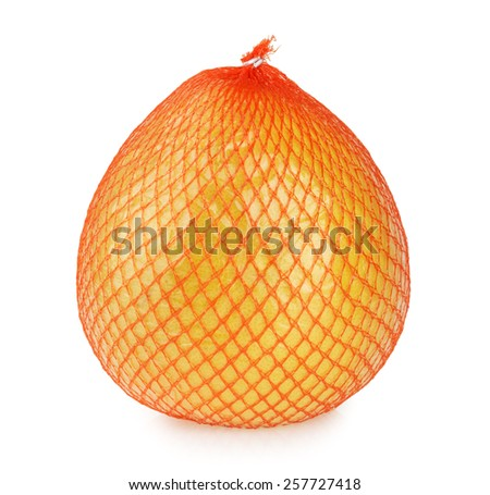 Pomelo fruit wrapped in net and plastic foil isolated - stock photo