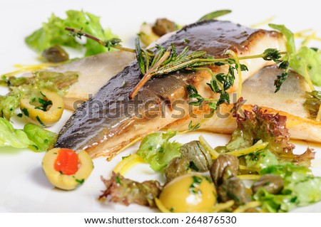 Pompano or dorada fish fillet fried and served with herbs - stock photo