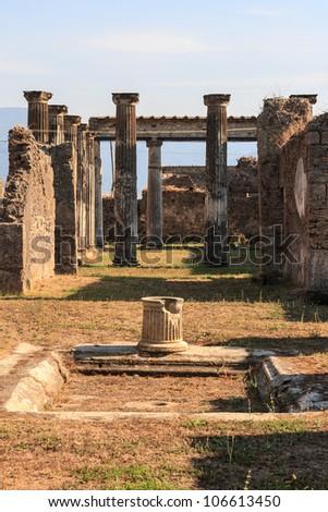 Pompeii ancient pillar ruins - stock photo