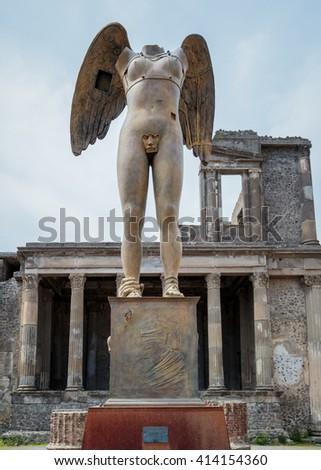 POMPEII, ITALY - APRIL 23, 2016: A statue in Pompeii. Pompeii is an ancient Roman city that was destroyed by a volcanic eruption. - stock photo