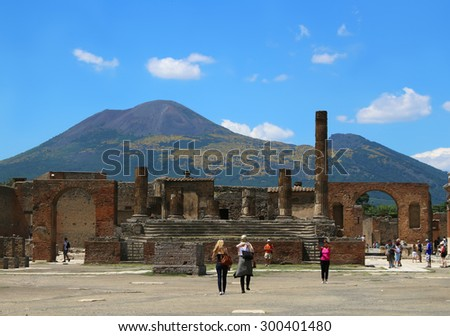 POMPEII, ITALY ,JUNE 27, 2015: People walking along the Forum in Pompeii, with volcano Mount Vesuvius in the background - stock photo