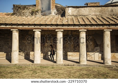 POMPEII - NOVEMBER 2: Roman archeologic ruins of the lost city of  Pompeii on November 2, 2014 in Pompeii,  Italy - stock photo