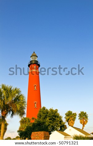 Ponce de Leon Inlet Lighthouse under afternoon sun - stock photo