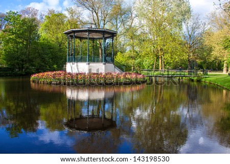 Pond and tulips in Vondelpark, Amsterdam - stock photo