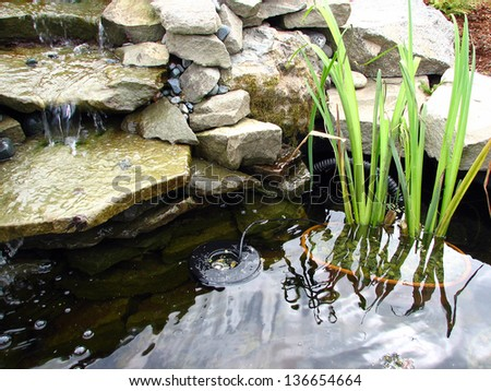 Pond with Waterfall and Fogger - Mister - stock photo