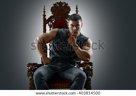 Ponderer muscular man on the throne - stock photo