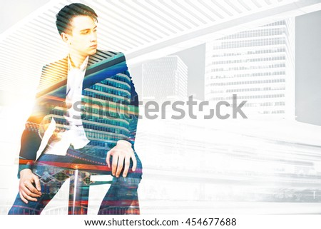Pondering young businessman on city background with copy space. Double exposure - stock photo