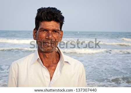 Pondicherry, SOUTH INDIA - JAN 18: Indian fisherman after fishing, his main work, during local Pongal Festival on January 18, 2013 in Pondicherry, Tamil Nadu, South India - stock photo
