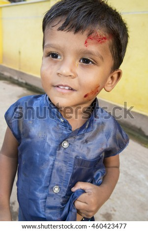 Pondicherry, Tamil Nadu,India - May 15, 2014 : each year in villages, people celebrate the temple fest, for the full day. They walk in groups, they launch paint on people, play music.