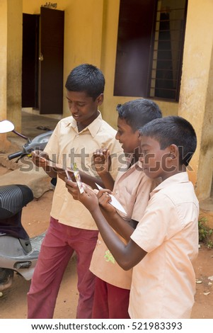 Pondichery, Tamil Nadu, India - March 03, 2014. In the school, teachers preparing the shooting photo of the students. Children very excited of this moment.