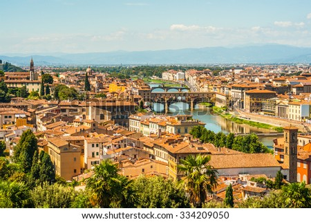 Pone Vecchio over Arno river in Florence, Italy. Beautiful image of italian renaissance architecture. Travel imagery of Italy. - stock photo