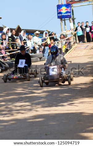PONGYANG, CHIANGMAI/THAILAND - JANUARY 15: The wooden cart racing in Hmong new year festival on January 15, 2013 in Chiangmai, Thailand.