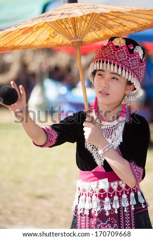PONGYANG, CHIANGMAI/THAILAND - JANUARY 4 : Unidentified traditionally dressed Hmong hill tribe girl play a ball in Hmong new year festival on January 4, 2014 in Chiangmai, Thailand. - stock photo