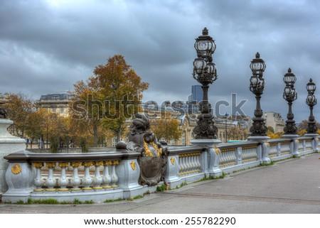 Pont Alexandre III across river Seine in Paris, France.  - stock photo