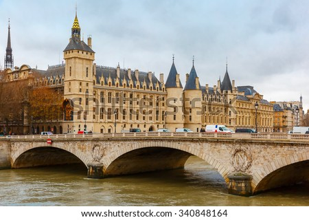 Pont au Change over the Seine River and the Conciergerie in Paris, France - stock photo