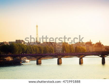 Pont des Arts and Seine river at sunny summer sunset, Paris, France, retro toned