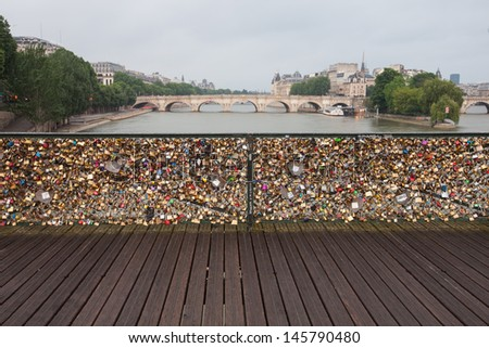 Pont des Arts key Bridge  across Seine river, Many peoples belive that if some one can unlock the they key so that he/she is soulmate, Paris France - stock photo