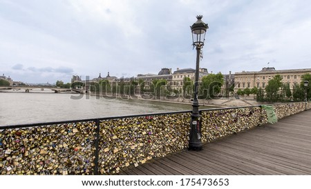 Pont des Arts pedestrian bridge in Paris looking over the Seine River
