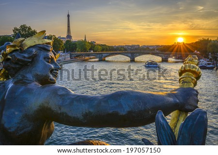 Pont des Invalides and Eiffel tower at sunset from Pont Alexandre III - stock photo