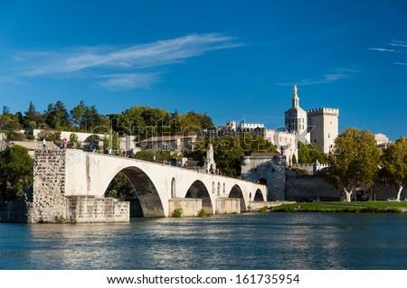 Pont du Avignon over Rhone river - Palais des papes and Notre dame des dome cathedral at Avignon - France - stock photo