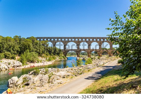 PONT DU GARD, FRANCE - JUL 21, 2015: Recreation area at the Pont du Gard, 1st century AD. Monument included in the UNESCO World Heritage List - stock photo