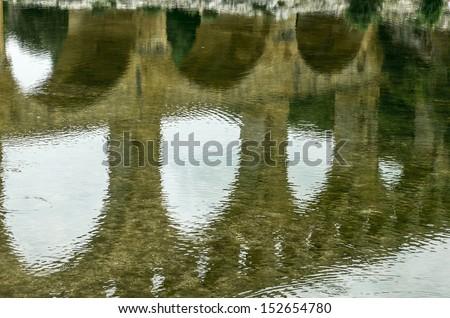 Pont du Gard (Gard, Languedoc-Roussillon, France), the famous bridge, Unesco World Heritage Site. Reflection. - stock photo