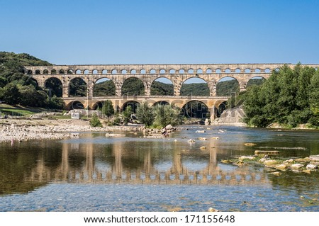 Pont du Gard in the morning, an old Roman aqueduct near Nimes in Southern France - stock photo