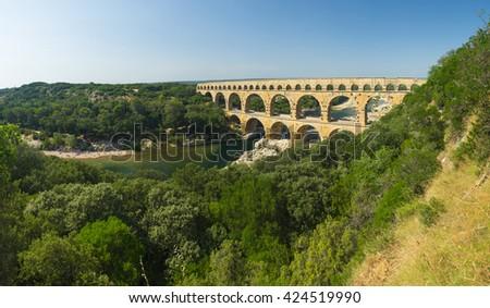 Pont du Gard is an old Roman aqueduct, southern France near Avignon. Panorama - stock photo