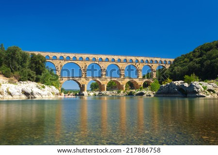 Pont du Gard old Roman aqueduct bridge near Nimes in Southern France, Provence, Europe - stock photo