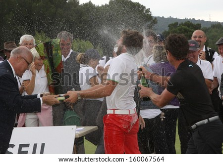 PONT ROYAL , FRANCE � OCTOBER 20, 2013 : Winner Edouard Espana (red pants) (FRA) During the  prize ceremony of the Masters 13  (Alps Tour), October 20, 2013 in Pont Royal en Provence, France.