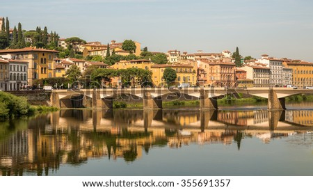 Ponte alle Grazie bridge, reconstructed after 1945, over the Arno River in Florence, region of Tuscany from Ponte Vecchio under Golden Sky Sunset in Summer, Italy