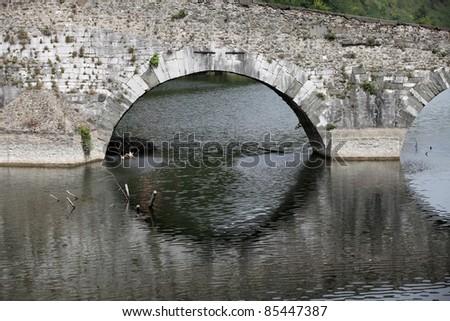 Ponte della Maddalena across the Serchio. Tuscany. Bridge of the Devil - stock photo